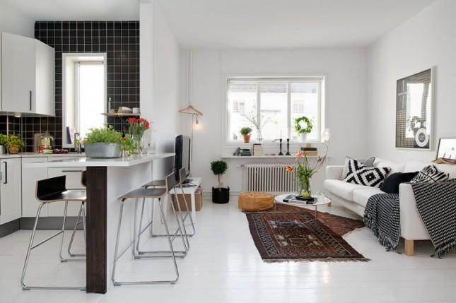 czarno-białe meszkanie,nowoczesny salon z kuchnią, otwarta zabudowa mieszkania,skandynawskie meszkanie,skandynawski styl