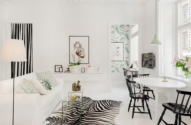 skandynawskie wnętrze,skandynawski salon,skandynawska inspiracja,biało-zielono-czarne wnętrze,mieszkanie w skandynawskim stylu,subtelne wnętrze,lekka aranżacja w bieli i zieleni,szczypta zieleni we wnętrzach,szczypta czerni we wnętrzach,zielone dodatki do wnętrz,czarne dodatki do wnętrz
