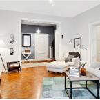 Piękne i świeże skandynawskie mieszkanie w inspirujących kolorach bieli, szarości i miodowego bursztynu