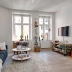 Jak zaaranżować mieszkanie o nieregularnym kształcie, czyli skandynawskie inspiracje z czerwoną cegłą
