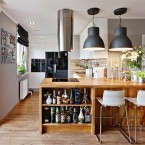 aranżacja kuchni z drewnianym półwyspem